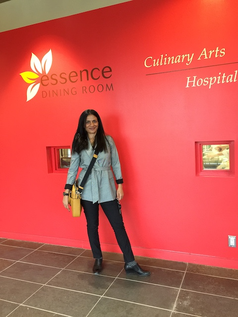 Rajita stands in front of the SLC Culinary lab